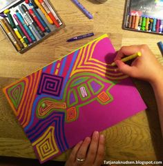 Mola design with construction paper crayons or oil pastel with dark construction paper