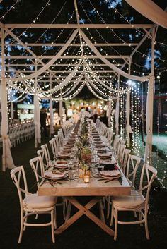 Fairy Lights | Incredible Outdoor Wedding Reception With Hanging Florals & Fairy Lights - Stylish Bali Wedding With A Fun Party Vibe With Bride In Lazaro And A Festoon Light Outdoor Reception With Images By James Frost Photography #WedWithTed @tedbaker