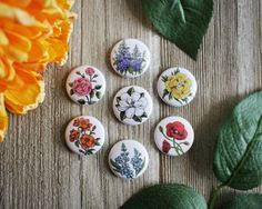 Set of seven pins or magnets of my vintage-inspired hand-painted flower illustrations. Just select whether youd like a set of pins or magnets!  Check out some of my other floral pieces: https://www.etsy.com/listing/462443478/mini-purple-delphinium-painting-on-wood?ref=shop_home_active_1  All work © walrus & toad.  Find me as @walrusandtoad on Instagram, Facebook and Twitter