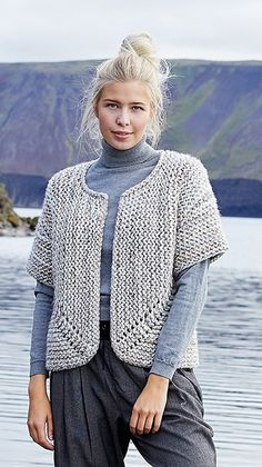 32a121e5605381 Free Knitting Pattern for a Jutka Cardigan with Chunky Yarn. Skill Level   Easy Short sleeves garter stitch cardigan to knit with bulky yarn.