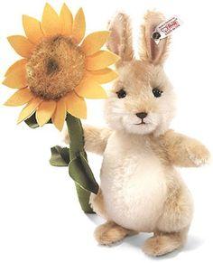 Sunny the Bunny - an adorable springtime rabbit holding a sunflower