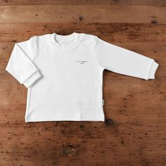 Made from skin-friendly organic cotton Comfortable clothing, no irritating tags or seams Also available in pink, blue and natural colour For babies in sizes: months Toddler Boy Outfits, Baby Outfits Newborn, Toddler Boys, Baby Shirts, Organic Baby, Comfortable Outfits, White Long Sleeve, Baby Tops, Baby Essentials