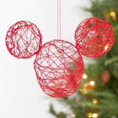Mickey String Ornament - Holidays  Nice to do various size plain globes in silver, gold or white with matching glitter. I left spot close to bottom open enough to slip a battery run votive candle into so you can turn it off and on.