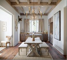 Grey wash farm table, barn wood floors and ceiling beams, chandelier. Love it all.