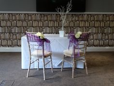 Bride & groom chairs with Cadbury purple organza sashes, wishing tree centre piece  Want your own quote? Then email me with your ideas! hello@beckiemelvinevents.co.uk  More styles can be seen at www.beckiemelvinevents.co.uk