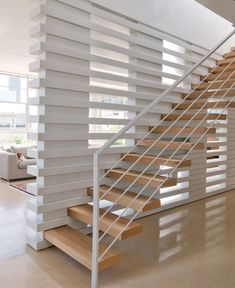 contemporary modern staircase with steel sides