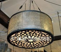 Modern Moroccan hanging lamp in the Islamic star geometric pattern. This hand-made moroccan chandelier is made in brass and lamp parchment.  Finish: Dark bronze patina. hand-rubbed finish.  Also available in 31.5 D for $1690.