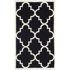 Hand-woven wool and cotton rug with a quatrefoil motif. Made in India.  Product: RugConstruction Material: Wool ...