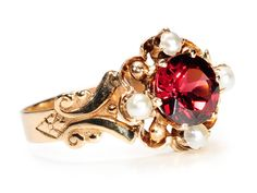 Edwardian Garnet Pearl Ring set in gold with garnet and half seed pearls, scrolled and engraved shoulders and smooth shank, circa 1890 Love how intricate this one is Red Jewelry, Gemstone Jewelry, Jewelery, Fine Jewelry, Jewelry Case, Jewelry Box, Edwardian Jewelry, Antique Jewelry, Vintage Jewelry
