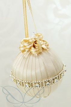 Christmas Ball - ribbon wrapped around ball & trimmed (no other info)