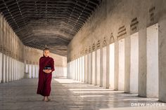 Walk The Corridor - Novice monk walking along the corridor to Shwezigon Pagoda, Bagan Myanmar.  Prints available from my website: www.drewhopperphotography.com  You can also find me on Instagram: @drewhopper   https://www.instagram.com/drewhopper/ See less