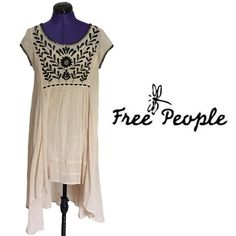 NWT free people Marina dress Boho gauzy high/low dress from Free People. Cotton slip under. Beautiful embroidery at top. The size is an XS and I am a size 4-6, the slip fits snug on me but the top is very flowy. Free People Dresses High Low