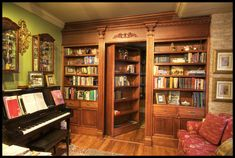 Nothing says old money like a piano and a room hidden behind warm wood floor-to-ceiling bookshelves. (from Indoor Billboards)