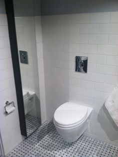 saving space and water TOTOs Aquia wallhung toilet via Houzz
