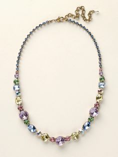 This classic line necklace has it all! A mix of cut crystals adorn your neck in endless sparkle. Nothing says beautiful like a woman that shines inside and out, and this necklace will help you do just that. All Sorrelli jewelry is covered by our exclusive Lifetime Warranty!