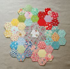 Flowers from different fabrics in the same color groups. Very cute!