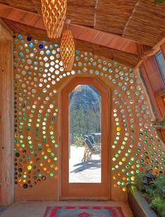 Cool bottle wall in an Airbnb earthship - Grand Designs Earthship Te Timatanga - Earth houses for Rent in Hikuai