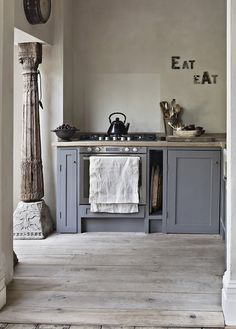 Blue gray cabinets with butcher block countertops, lighter grey walls ( then buttermilk trim on window and ceiling and dark stained wood uppers with as much glass and as little wood as possible with the same grey as lowers behind it)