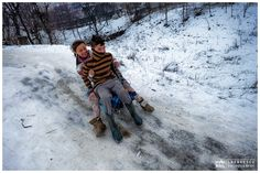 Winter games ... - Traditional Romanian winter games in the village. Two kids having fun on the sledge in the village.