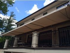 Large 40 foot wide retractable folding lateral arm awning