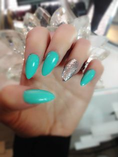 Tiffany turquoise blue and silver pointy nails :) nice and bright