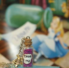 Alice in Wonderland Drink Me Bottle Necklace in  Psychedelic Pink with a Rabbit Charm via Etsy