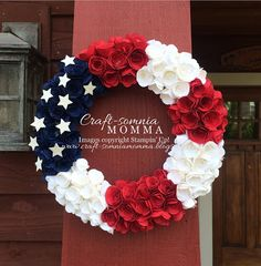 wreath of rolled paper flowers ... red, white and blue ... luv the stars on the navy section ...