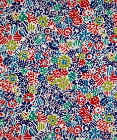 LIberty London / Loosely inspired by an archival print from 1965, this is a modern polka dot hatched floral with linear lines and geometric structure.