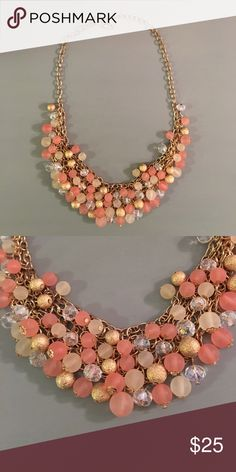 Gold & Pink Statement Necklace Statement necklace with pink, gold, and clear baubles. The gold accents give off a beautiful shine when light hits it. Smoke-free home. Jewelry Necklaces