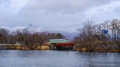 Winter Hokkaido Local Train Crosses Bridge