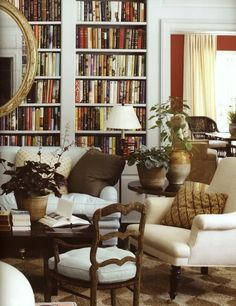 20 Interior Designers I Would Hire {part I} - laurel home | Jeffrey Bilhuber | lovely living room which also doubles as a library