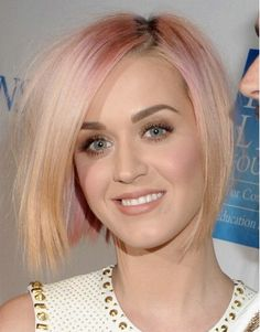 Katy Perry with blond hair and pink highlights, I would never do this but love it