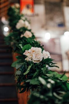 October 2015 | Toronto ON | www.kjandco.ca | KJ and Co. coordination and design at Ainsley & Matt's Balzac's Coffee Roaster's, Distillery District wedding | Photo by Claire Dam Photography | As seen on TheWeddingCo.com | cocktail wedding reception | stairway decorated with greenery garland and roses