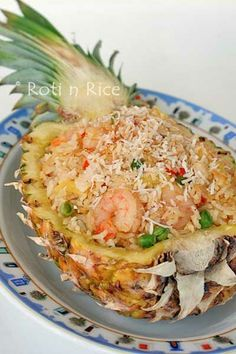 Fried rice with a truly Southeast Asian flavor of pineapple, coconut, and lemongrass serve in a pineapple boat