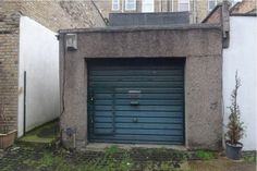 A derelict garage down a side street in Stoke Newington, north London has been sold for £375,000, the same price as a three-bedroom-flat. The building contains no kitchen, bathroom or bedrooms but does cover 750 square ft and comes equipped with a scattering of green cupboards to match its walls. Official photographs from Hackney-based estate agents Courtneys reveal the new owner will also discover a pile of brown dirt and mis-matched flooring in the corner of their property.