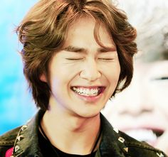 Onew! Just in case you had a bad day remember, A real smile is contagious So please stare until you smile!:)