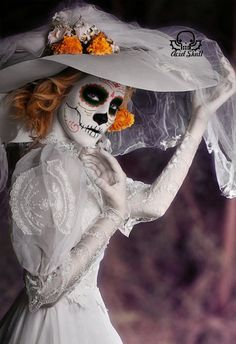 A popular figure of the Day of the Dead celebrations that take place in Mexico is a Catrina - a skeletal female vision that usually wears elaborate hats upon her head and is often seen carrying a bouquet of flowers.