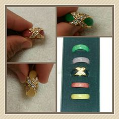 Coordinate ladies! 5 Interchangeable colored bands fits perfectly into the gold tone ring. Green Purple Black Red Yellow Size 7 Absolutely stunning! High quality jewelry! Jewelry