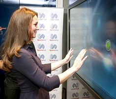 As a patron of SportsAid, Prince George's athletic mom was on hand to meet young Olympic hopefuls looking to compete in the 2020 Olympic and Paralympic Games in Tokyo. Not only did she speak with the young athletes, but she also took some of the cognitive tests available at the Southampton facility. One involved pressing on a TV screen to test her reflexes.
