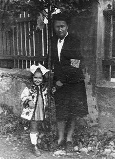 """Mira Binford, at age 3,with her mother Dora wearing Jewish armband. Thousands of Jewish children lived in Bedzin, Poland before the Nazi invasion. Only about a dozen survived. Binford's film, Diamonds in the Snow, shows the stories of three very young children, including the filmmaker, who were saved from the Nazis by Polish strangers."""