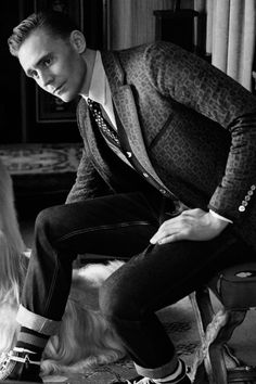 """""""Tom Hiddleston has landed his first major fashion campaign as the face of Gucci's cruise 2017 men's tailoring ad. Posing with Afghan hounds in some incredibly sharp suits, the actor looks right at home."""""""