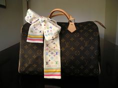 Louis Vuitton Monogram Speedy 35 with MC Bandeau bow.