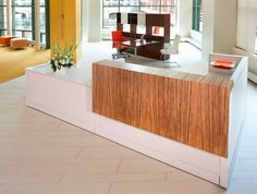 contemporary reception desk: Replace wood with blue tiling