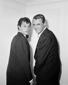 Tony Curtis and Cary Grant... look like they've been sprung doing something naughty...