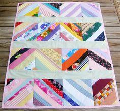 Strip quilt from scraps.