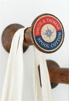 These Vintage Style Wood Spool Wall Pegs offer a creative way to hang coats, dog leashes and more. The set of four oversized wood spools feature different reproduction vintage labels with logos from sewing thread companies. Inspired by flea market finds, these spools make great, secure hooks—perfect for a craft room.