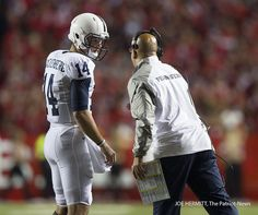 PENN STATE – FOOTBALL 2014 – Penn State quarterback Christian Hackenberg talks with head coach James Franklin during the 3rd quarter at High Point Solutions Stadium on September 13, 2014. Joe Hermitt, PennLive