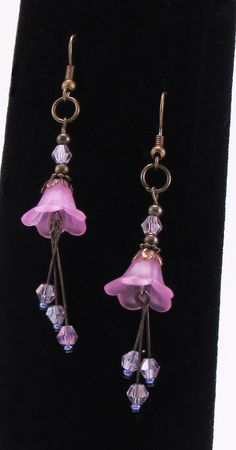 "Delightful! I just love how lightweight and dangly these earrings are, they are just too cute not to show off with an ""updo"" hair style. They are made with antique style bronze metals, lucite flowers and pretty pink Czech crystal bicone beads.  $18.00"