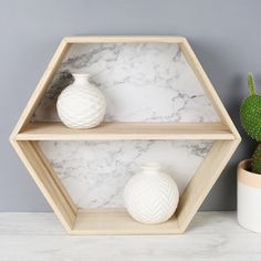 This Marble Effect Wooden Hexagon Wall Shelf from The Lisa Angel Homeware Collection will update your home. With Free Worldwide Delivery and No Minimum Spend.