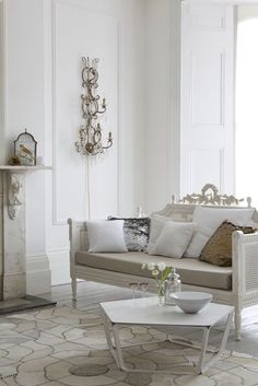 "whites  - it just works, love the ""white"" cowhide rug ( shapes and stiches make it interesting ) and sconce"